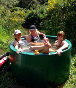 wild women in wild water hot tub on Re-wild Yourself retreat for nature connection